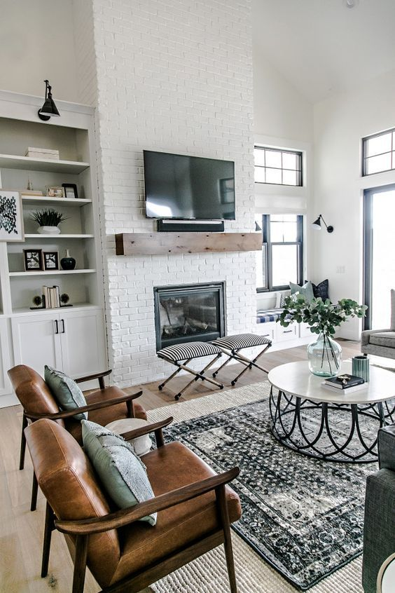 a neutral space with a boho feel, a built in fireplace in a whitewashed brick wall
