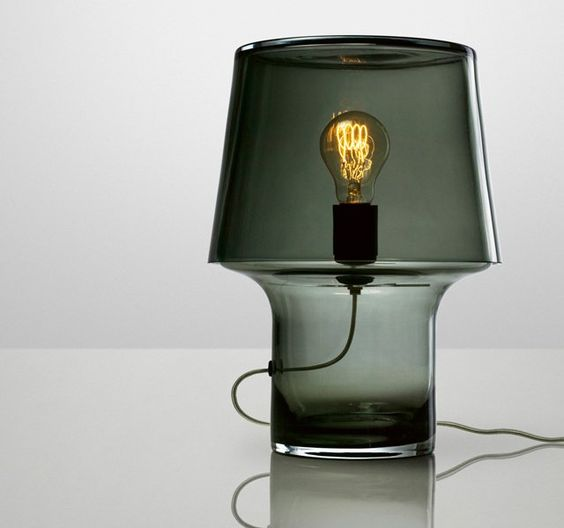 a smoked glass table lamp with a bulb looks very whimsy yet brings coziness