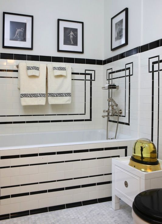 mosaic white tiles with black geometric patterns clad is a creative and chic idea