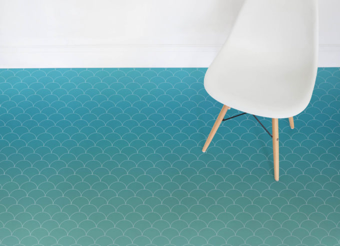 Mermaid vinyl flooring reminds of fish (or mermaid) scale and the color scheme fits
