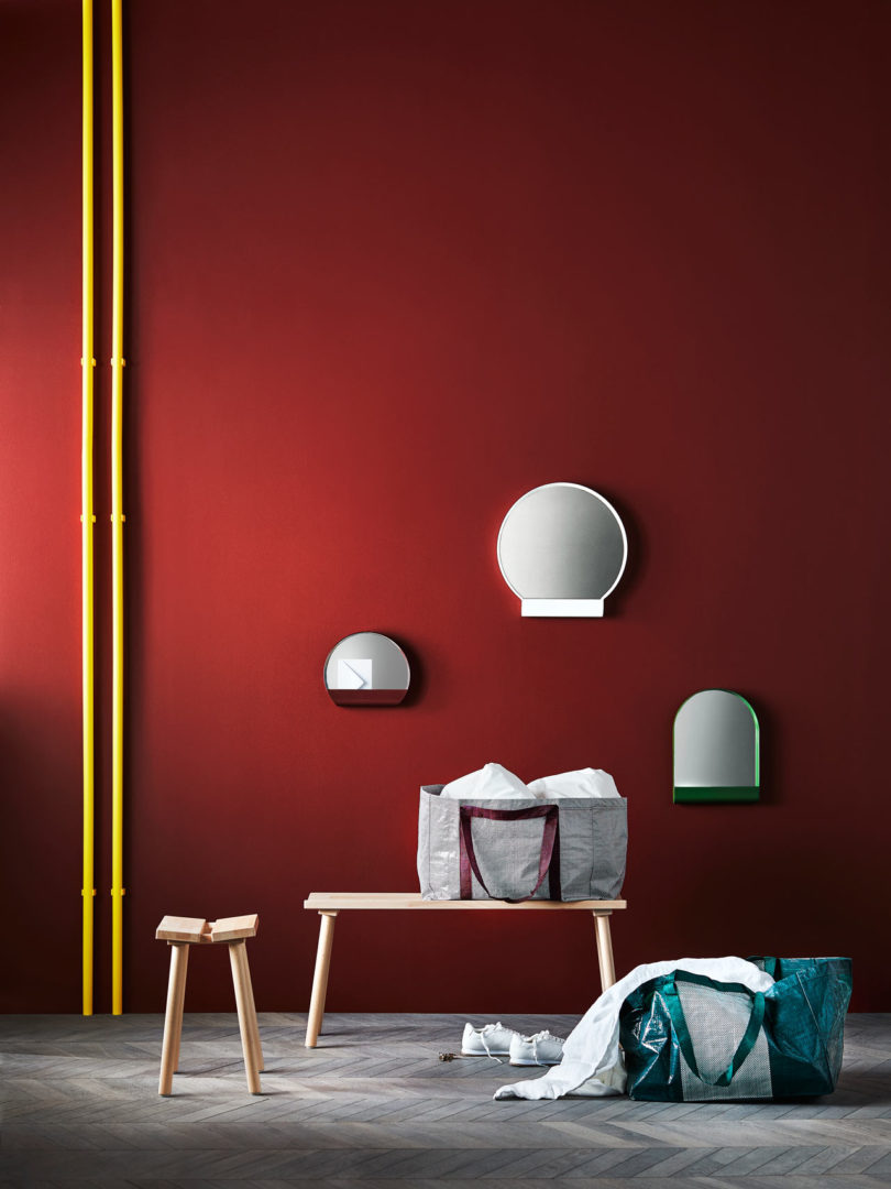 Small mirrors in colorful frames are great for small entryways