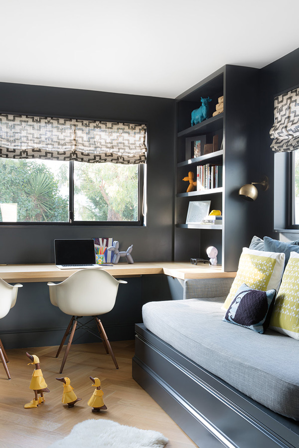 The home office is done in graphite grey, with a wall-mounted desk, it's a shared space, which is enough for two or more people