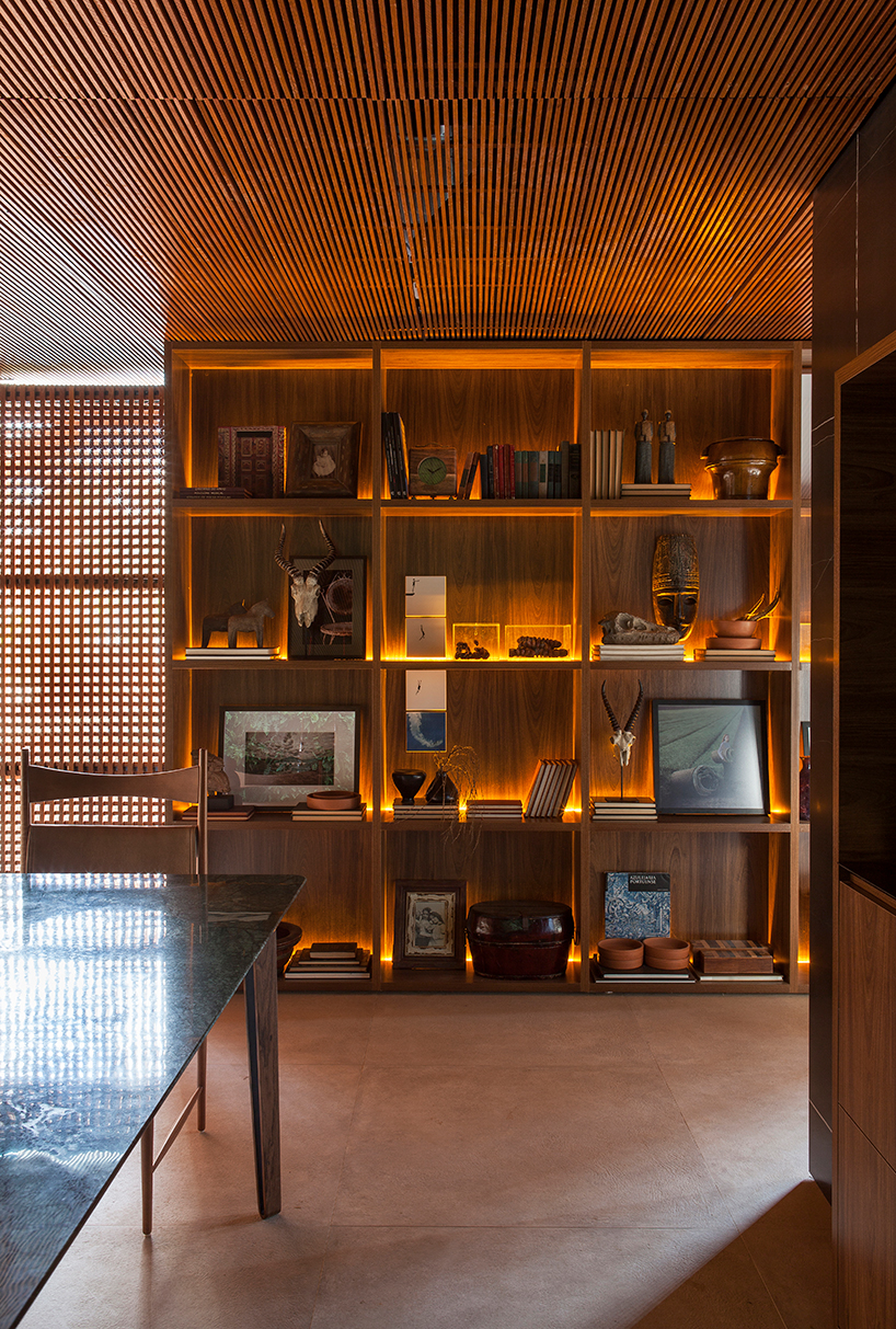 The shelving unit is lit up to make it more spectacular and chic