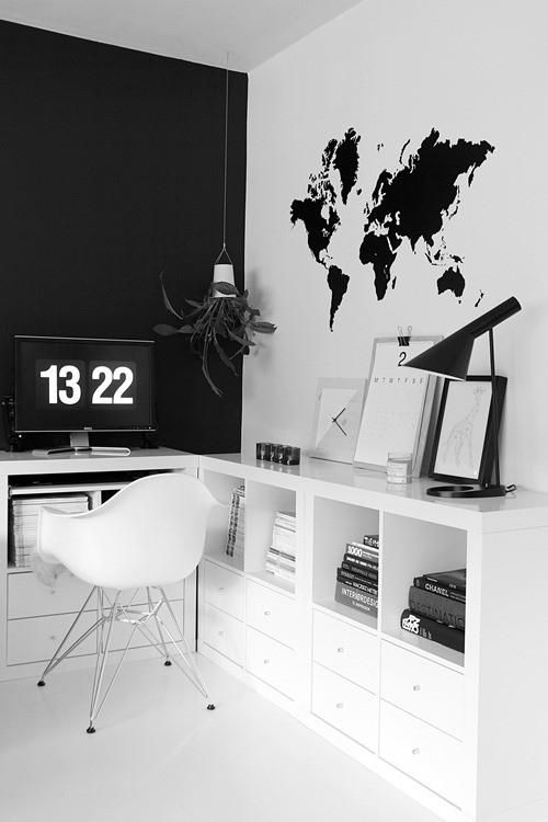 a Scandinavian home office with a black statement wall and a white one with a world map decal looks bold