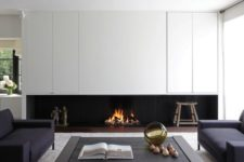 07 a minimalist living room with a built-in fireplace under the cabinets