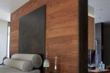 07 a modern bedroom with a headboard wooden wall and pebbles for a relaxing feel