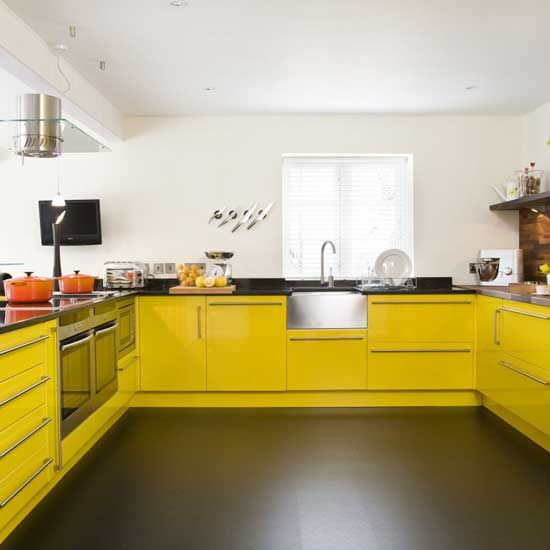 a modern yellow and black kitchen is sure to raise your mood with its contrasting colors