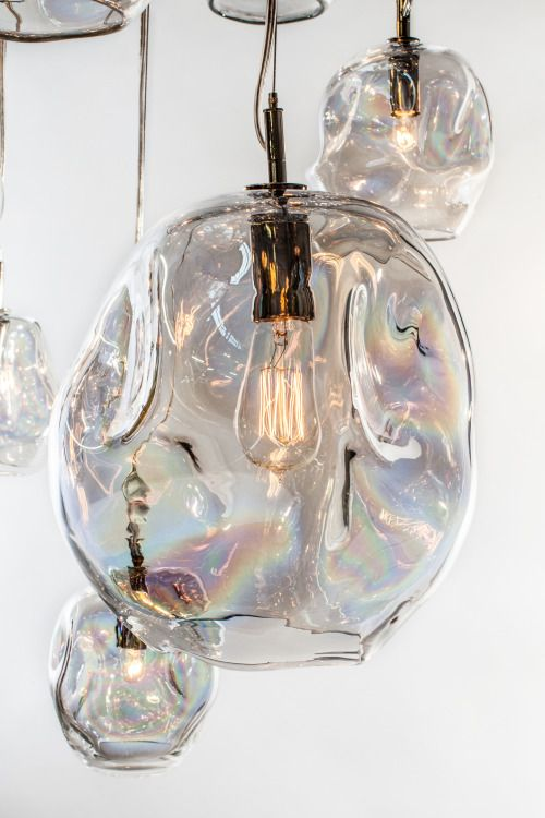 a unique transparent lamp of a very eye catching shape that shows imperfections at their best