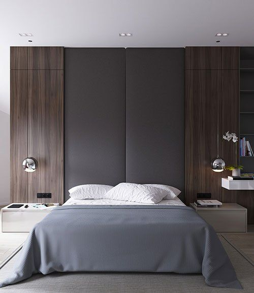 an eye-catchy headboard wall with upholstery and dark wood, chic silver bubble hanging lamps