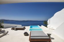 08 Modern comfy loungers and some cute side tables are placed around pools