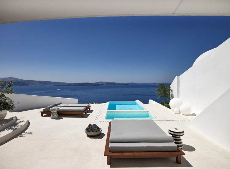 Modern comfy loungers and some cute side tables are placed around pools