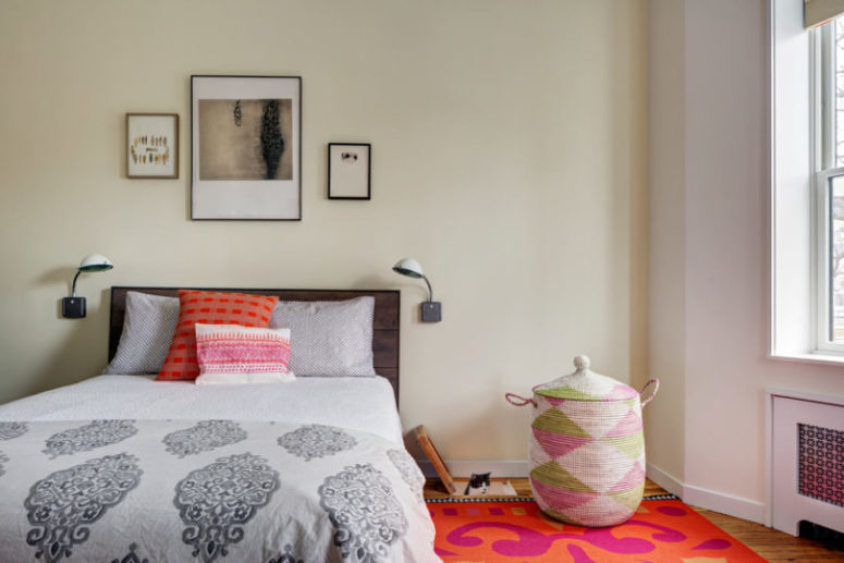 The master bedroom is a bright space with bold textiles, printed pillows and some cat retreats