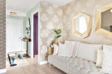 08 There are two types of wallpaper, a creamy velvet sofa and again brass touches to accentuate the space