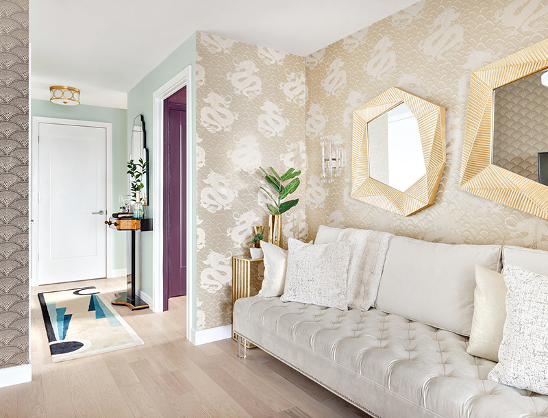 There are two types of wallpaper, a creamy velvet sofa and again brass touches to accentuate the space