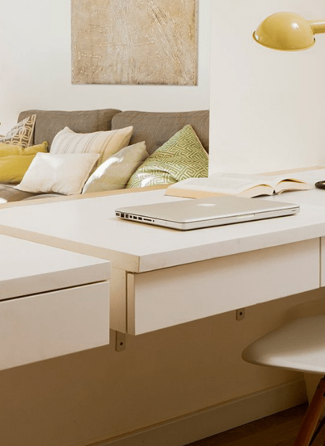 This home office space separates the open layout from the kids room