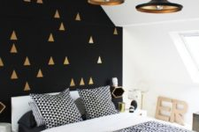 08 a Scandi space with a mid-century modern feel and a black wall with a gold tirangle print