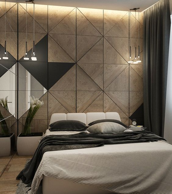a moody space with a wood geometric headboard wall, glass lamps hanging in clusters