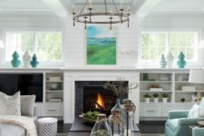 08 a neutral farmhouse space with a built-in fireplace and some aqua-colored touches