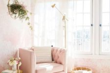 08 a nook by the wall taken by a pink chair, a floor lamp and a brass side table as a glam reading space