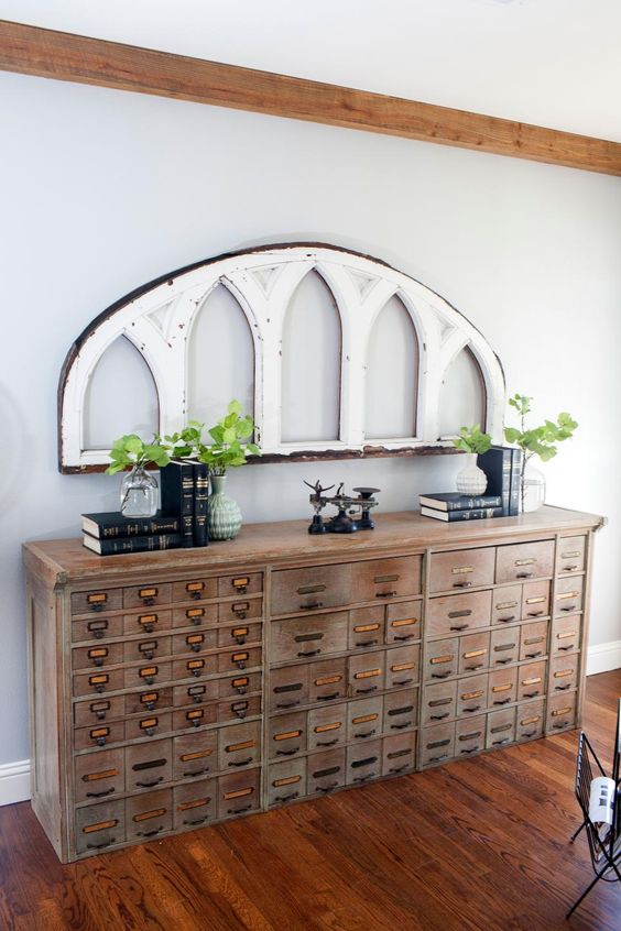 a vintage wooden apothecary cabinet as a gorgeous console table