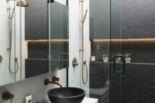 08 black hexagon tiles on the wall and floor in the shower to make the shower stand out