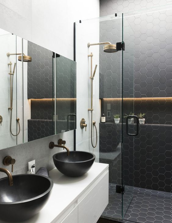 black hexagon tiles on the wall and floor in the shower to make the shower stand out