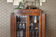 09 A cool wooden and glass bar cabinet with a geo mirror over it added to the interior