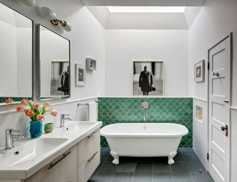The bathroom is also colorful, with green fish scale tiles and a neutral double vanity