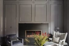 09 a chic moody space with graphite grey walls and a built-in fireplace, a crystal chandelier is a gorgeous statement piece