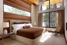 09 a gorgeous space with a wood clad wall with an additional window for more light and a large window to bring the views in