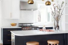 09 a graphite grey and white kitchen is made more glam with brass lamps and handles