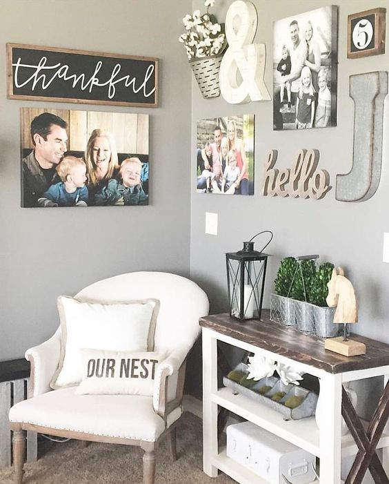 a small nook with a comfy chair, a console table and family photos and signs all over