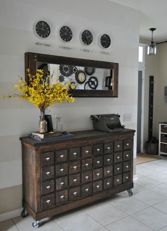 a vintage apothecary cabinet on casters as a stunning antique entryway  console - 27 Cool Ways To Use An Apothecary Cabinet In Your Interior - DigsDigs
