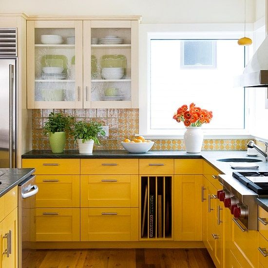 farmhouse space with sunny yellow cabinets and a gorgeous printed yellow tile backsplash to match