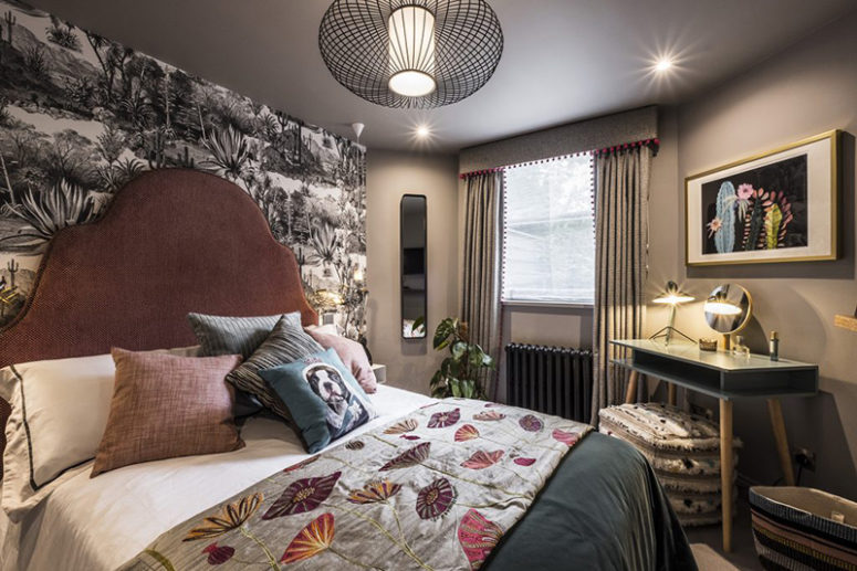 The guest bedroom features a black and white botanical print wall, printed textiles and modern furniture