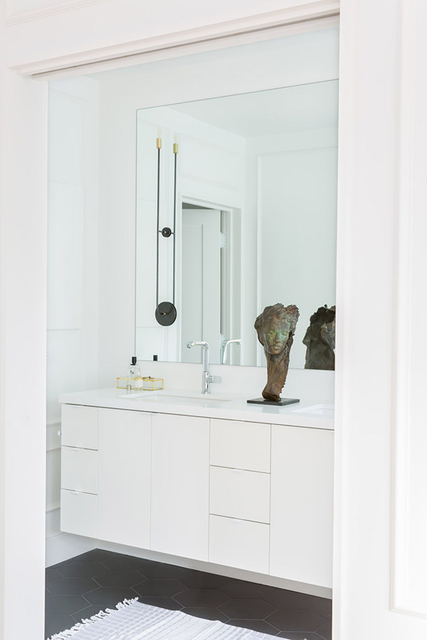 The master bathroom is sleek, modern and white, nothing unnecessary here