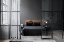 10 a sexy masculine bedroom with a black headboard wall and a leather upholstered bed for an eye-catchy look