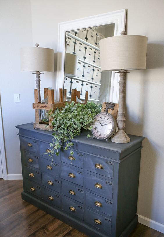 a vintage cabinet painted in graphite grey as a chic and unusual entryway console