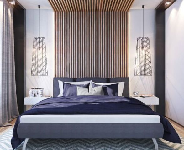 an eye-catchy vertical slat wall coming up the ceiling, geometric lamps and a colorful uphlostered bed
