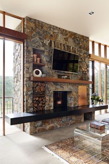 chic texture and bold earthy colors make this fireplace amazing, and a black mantel and firewood storage is awesome