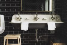 10 glossy black subway tiles for a masculine art deco bathroom and brass touches to make it chic