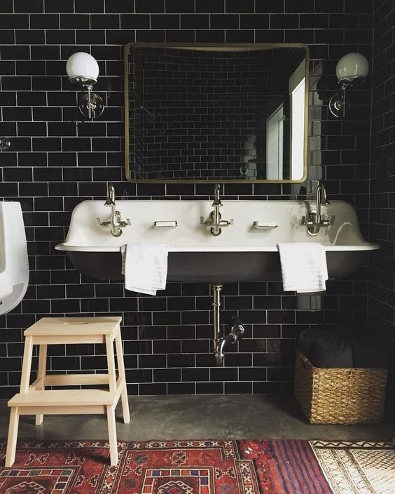 glossy black subway tiles for a masculine art deco bathroom and brass touches to make it chic