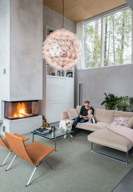 this modern built in fireplace is like a sculptural element in the living room