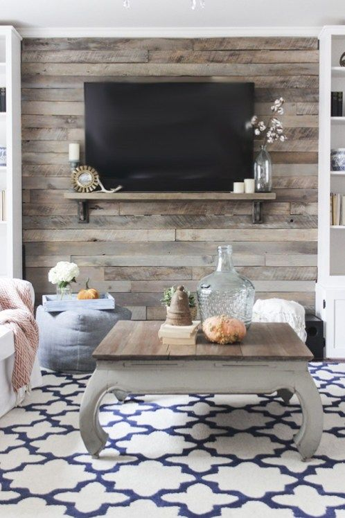 a cozy space with a rustic reclaimed wooden wall and a coffee table that matches