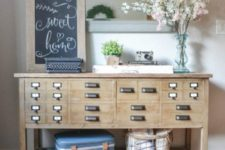 11 an apothecary cabinet turned into an eye-catchy console table for an entryway