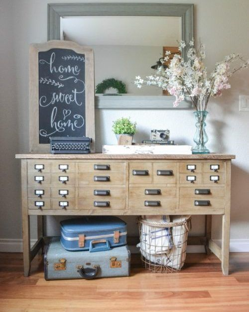 an apothecary cabinet turned into an eye-catchy console table for an entryway