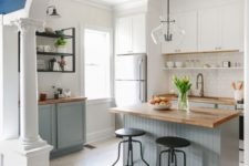 11 lower dove grey cabinets and white uppers with natural wood countertops for a cozy natural feel
