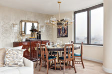 12 The dining space is by the window, there's a wooden dining set with teal seats and an eye-catchy cabinet