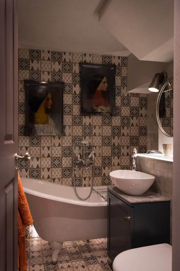 The second bathroom is clad with mosaic tiles and there portraits to make it artistic