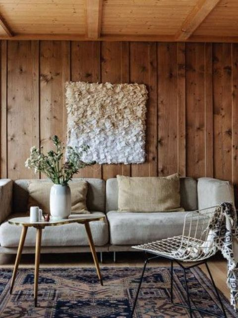 a cozy space with wooden panels and a ceiling for coziness, a fluffy artwork accentuates it